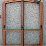 Porta 2 ante apertura esterna – arco sesto ribassato